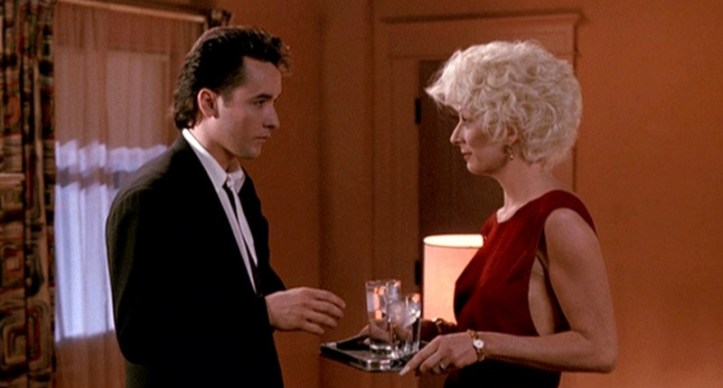 The-Grifters_John-Cusack-Angelica-Huston-red-dress-side_cap.jpg
